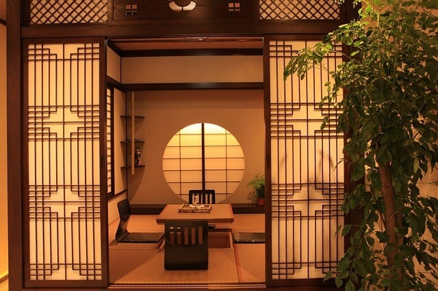 Ryokan Room with tatami mat, low table and legless chairs