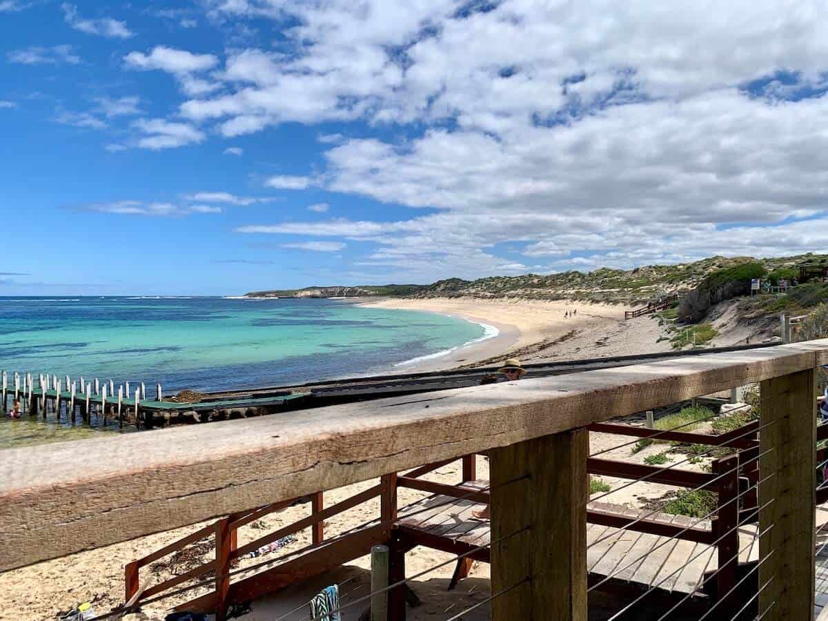 Highlights of South Western Australia cover photo of a wooden boardwalk above a white sand beach and blue ocean