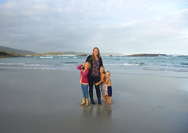 Keri Hedrick from Our Globetrotters on the beach with her 2 children