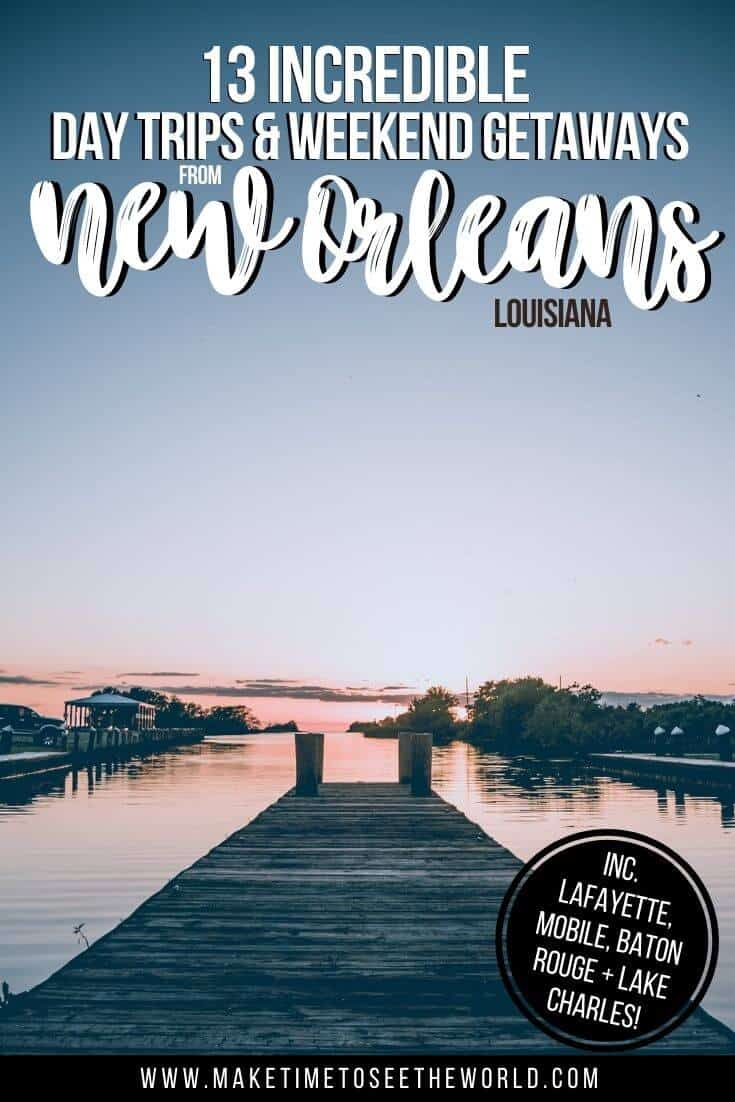 13 Day Trips from New Orleans Weekend Getaways pin image of a wooden pier leading out to a lake, flanked by small islands at dusk, the water reflecting a slight pink colour