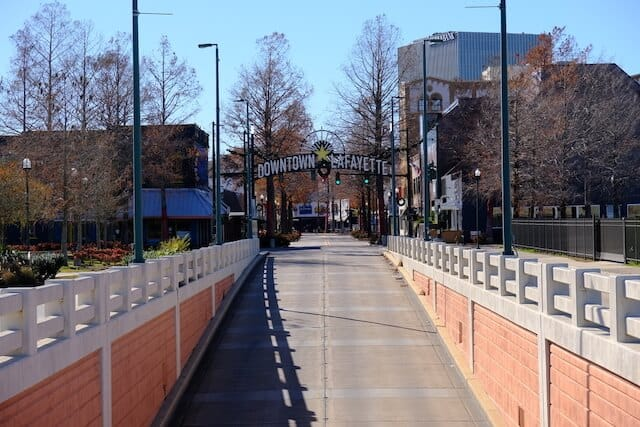 Walkway ramp rising up to the arched Downtown Lafayette sign