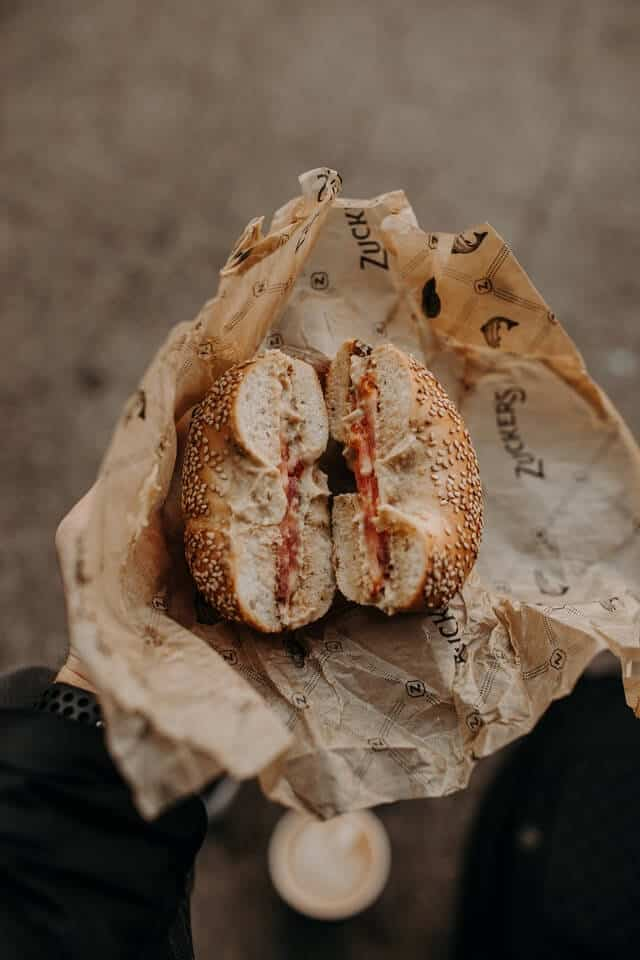 Bagel in a paper wrap to eat on the go