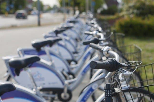 Citi Bikes lined up along the sidewalk