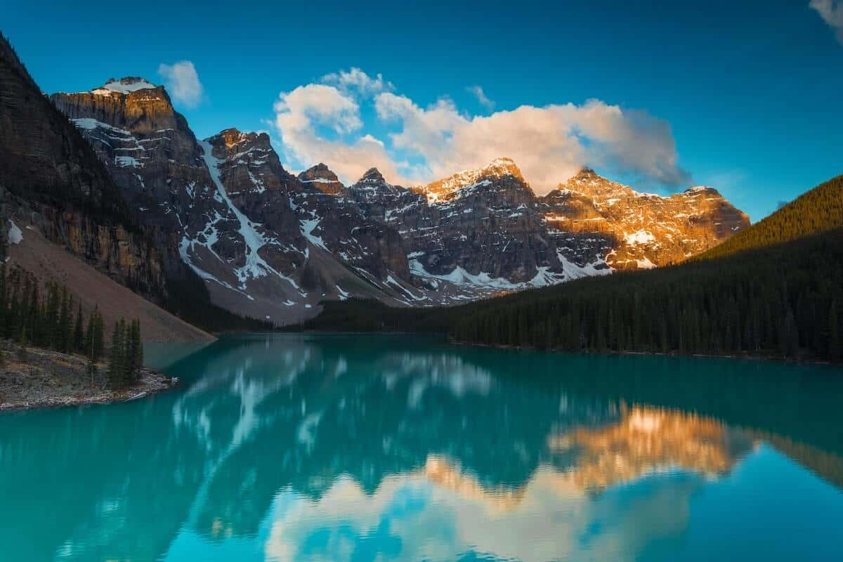 Things to do in Banff in Summer cover image of an Emerald Lake with a rocky mountain backdrop under a blue sky