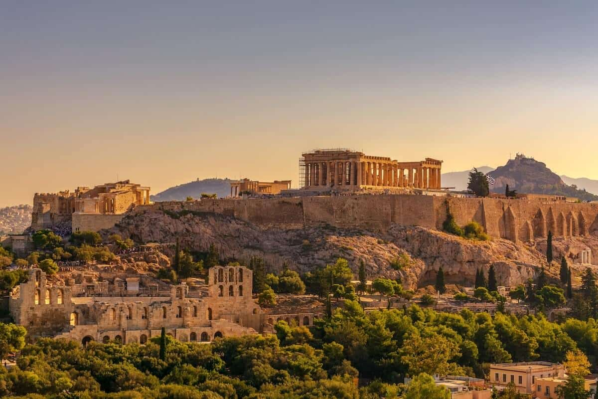 Free Things to do in Athens Greece cover photo of the acropolis on the hill at sunset