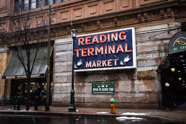 Neon sign of the Reading Terminal Market on a Stone Wall