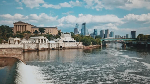 River in Philadelphia with historical buildings in the background