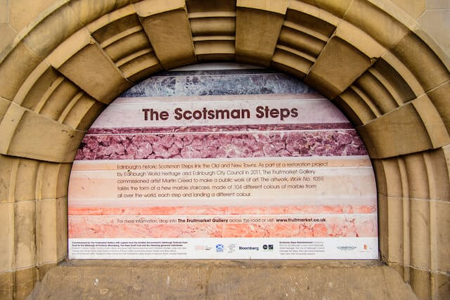 Scotmans Steps sign embedded in a stone archway