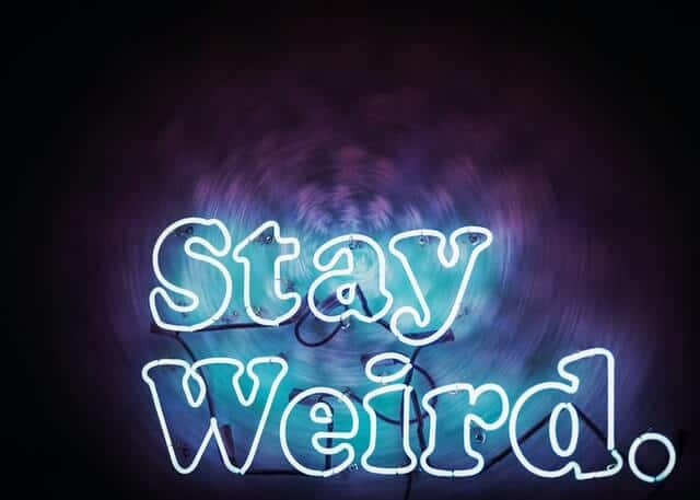 Neon 'Stay Weird' sign light up in blue/purple in Philadelphia