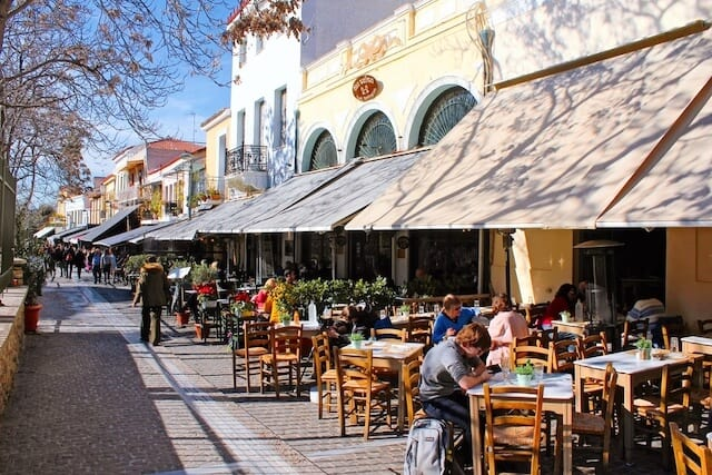 Street lined with cafes and shops in Thisseio Athens
