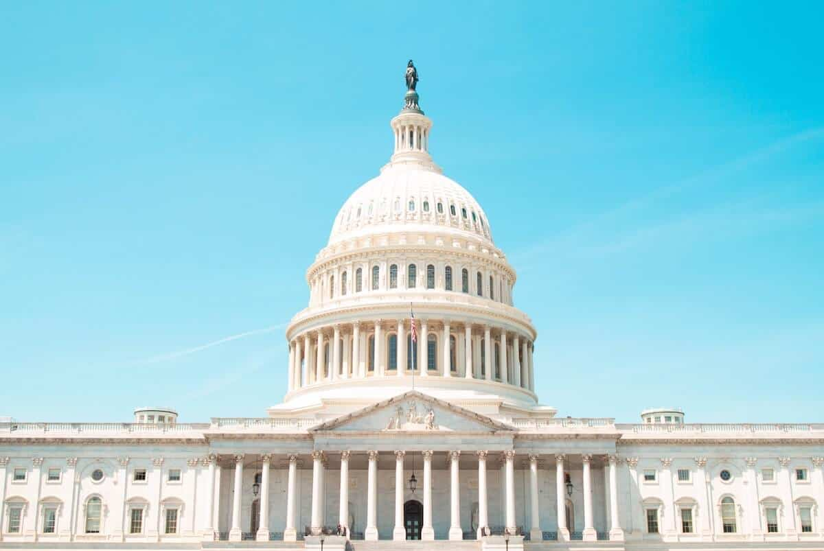 Free Things to do in Washington DC header image of the Capitol Building in front of a bright blue cloudless sky